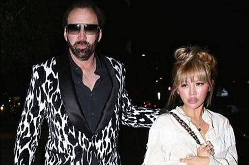 CAGEY ABOUT MARRIAGE: Maybe Nicolas Cage does not like to be caged up. How else to explain his decision to file for an annulment of his marriage to Erika Koike (both above) just four days after they got married, reported Entertainment Tonight. Cage,