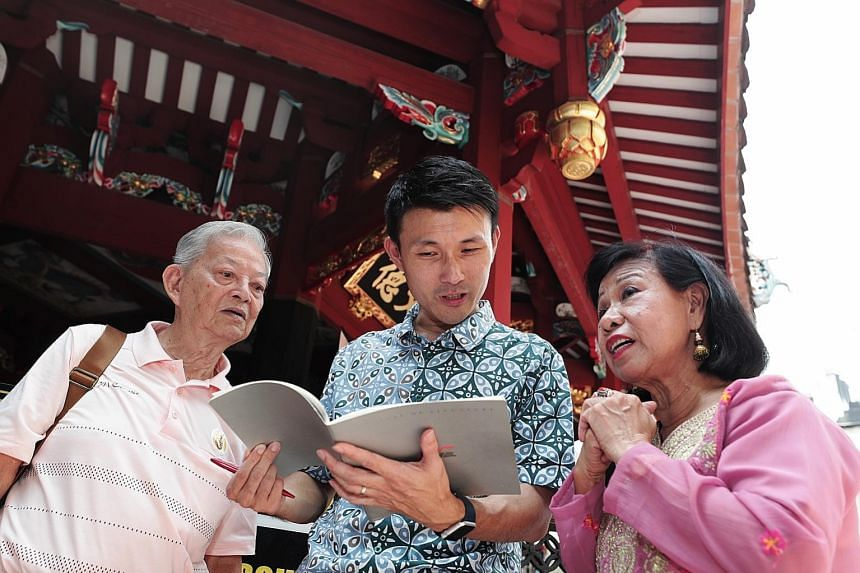 Retired clerk Ang Beng Thong, his wife Yee Mei Lin and Senior Parliamentary Secretary Baey Yam Keng at the launch of the new Maritime Heritage Trail yesterday. The trail starts at the Thian Hock Keng Temple and ends at the Malay Heritage Centre.