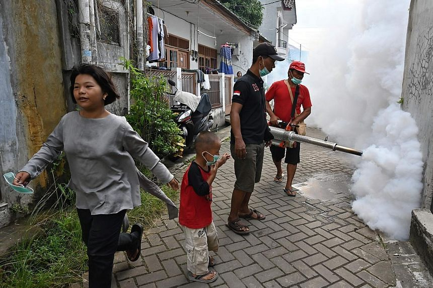 Mosquito fogging being carried out in Banten, Indonesia. The threat of mosquito-carried viruses can be lowered through measures such as using insect spray, but the more effective way to limit expansion of the diseases is to curb climate change and fu