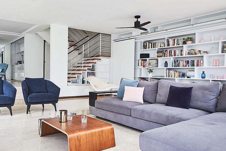 (From far left) Velvet blue chairs add colour to the monochromatic palette; sliding doors and windows let plenty of natural light into the kitchen; and windows above the entrance allow heat to dissipate from the interior of the home. (Above) As the h