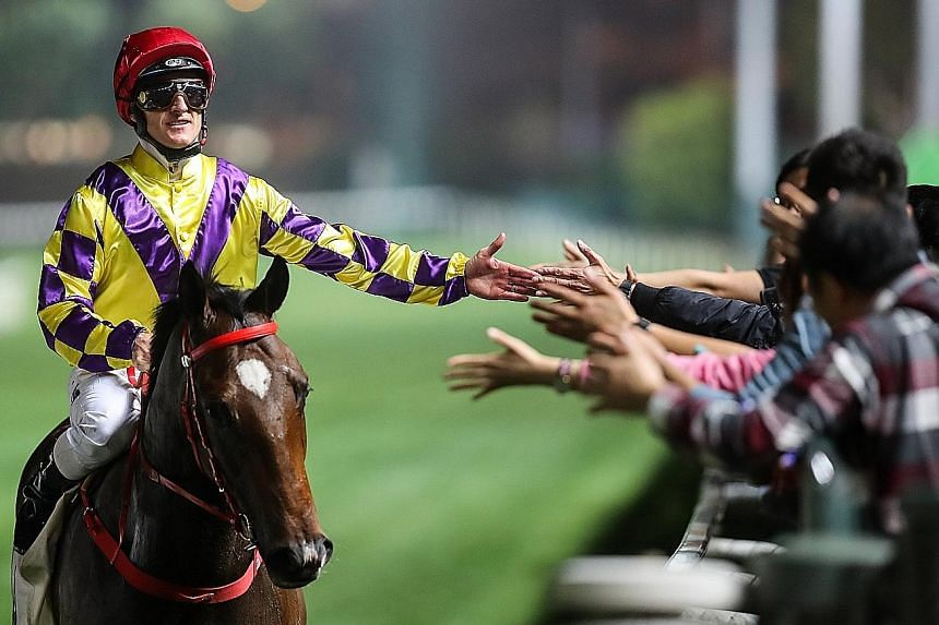Champion jockey Zac Purton being congratulated after winning on Champion's Way on Feb 20. The three-from-three winner will be ridden by Joao Moreira, who rode the horse to its debut win, in Race 7 at Sha Tin tomorrow.