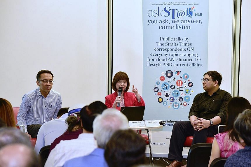 Senior Minister of State for Health Amy Khor speaking at the session yesterday on the Merdeka Generation Package at the National Library in Victoria Street. With her are Permanent Secretary for Health Chan Heng Kee (left) and ST news editor Zakir Hus