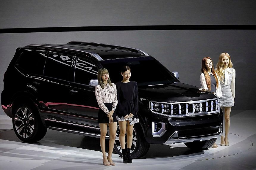 Kia showcased three concept cars - Mohave Masterpiece (above, with South Korean girl group Blackpink), SP Signature and Imagine - to support its ambition to dominate the sport utility vehicle segment.