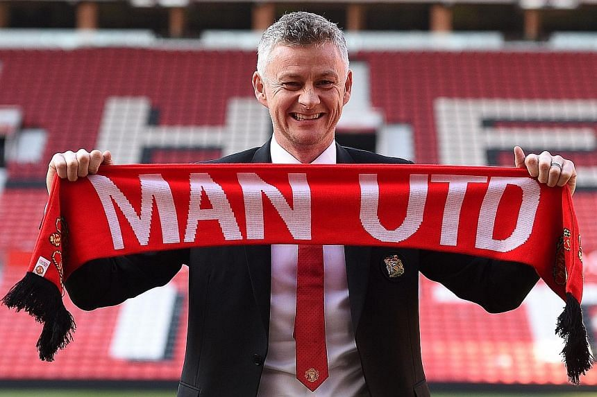 Ole Gunnar Solskjaer posing during a photo call at Old Trafford on Thursday after being confirmed as Manchester United manager.