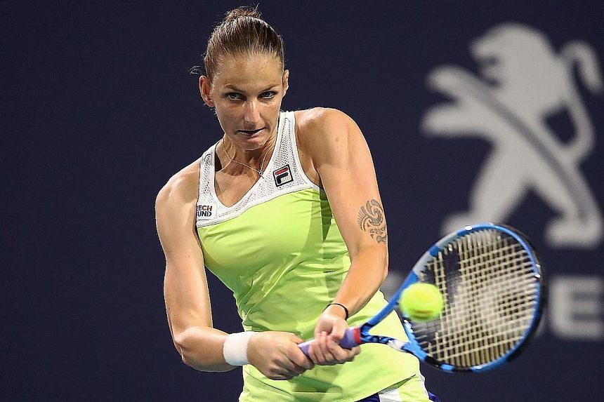 Karolina Pliskova hitting a return to Simona Halep as she defeated the Romanian in their Miami Open semi-final on Thursday. The Czech reached her first Miami final where she will face Australian Ashleigh Barty, who tamed Anett Kontaveit of Estonia 6-