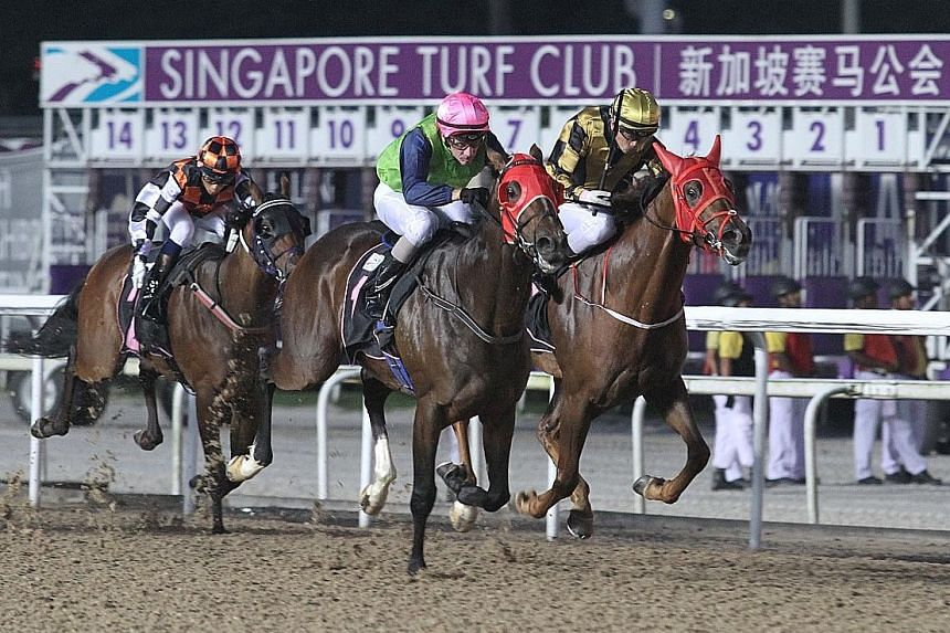 Athletica (pink cap) racing away to beat outsider Storm Ryker (inside) at Kranji last night.