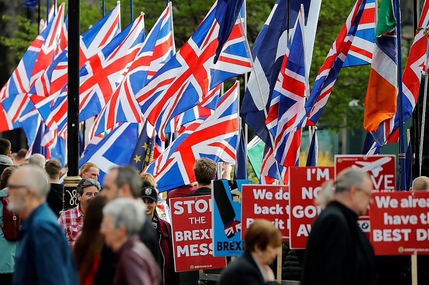 Pro-Brexit activists and anti-Brexit demonstrators outside the Houses of Parliament in Westminster in London on Thursday. It is unclear if British Prime Minister Theresa May has the political capital left to try her deal a fourth time.