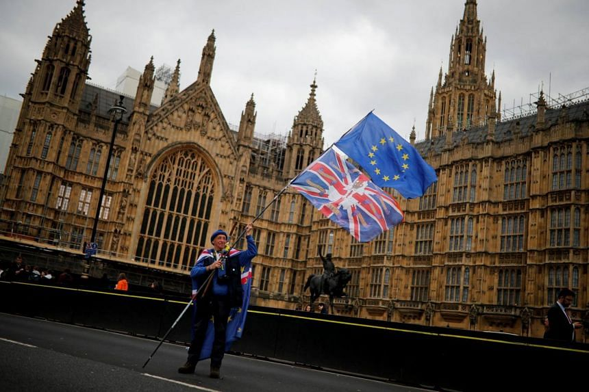 An anti-Brexit protester stands outside the Houses of Parliament, in London, Britain, on March 27, 2019.