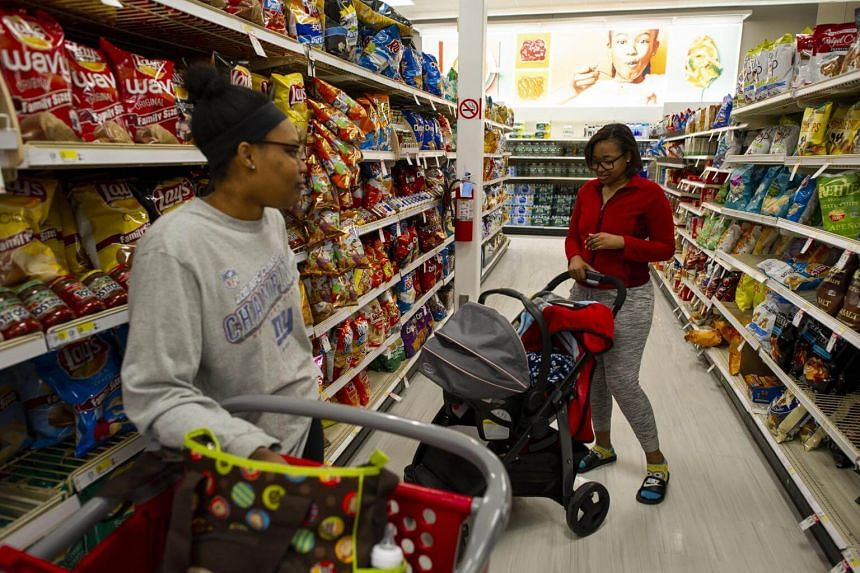 Erica Wingate, right, with son Cassius, inside a Target that is said to have been exposed to the measles outbreak, in Spring Valley, New York, on March 27, 2019.
