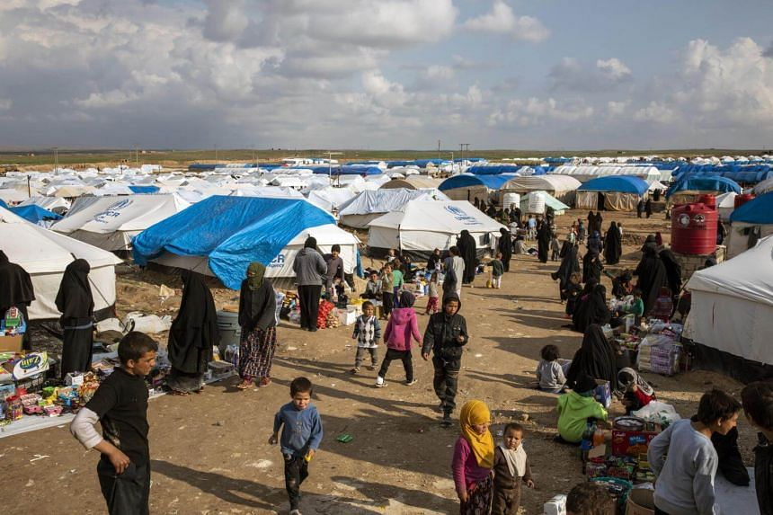 Women and children who fled the Islamic State's last areas of control in Syria at the Al Hol camp in northern Syria, on March 28, 2019.