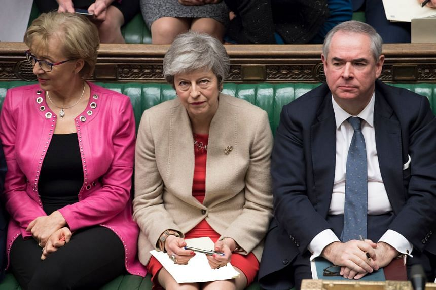 Theresa May glances up during a debate on Brexit in the House of Commons in London on Friday, March 29, 2019.