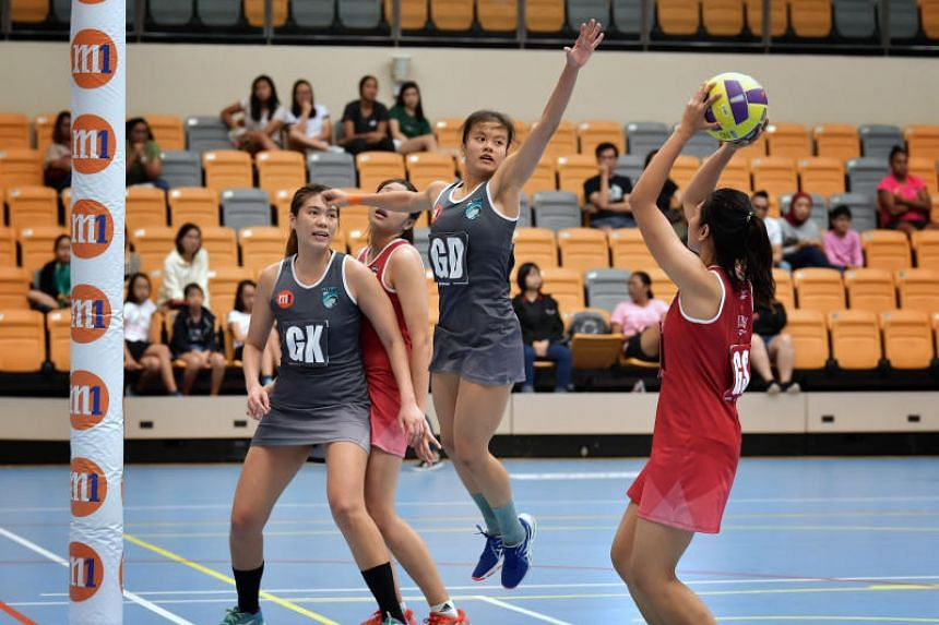 Llabten Narwhals's Rachel Ling (second from right) jumps to block a shot during the Netball Super League against Swifts Barracudas on March 30, 2019.