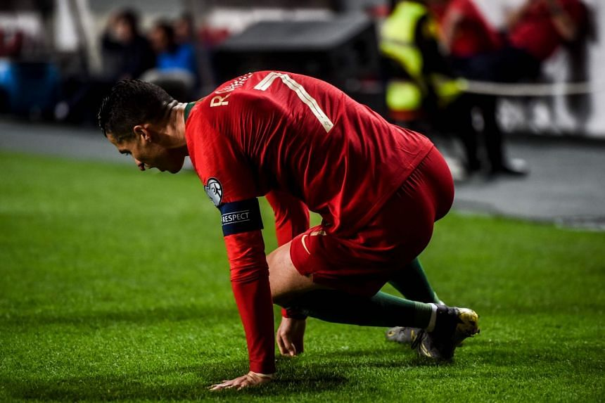 Ronaldo sits on the pitch during the Euro 2020 qualifying match between Portugal and Serbia.