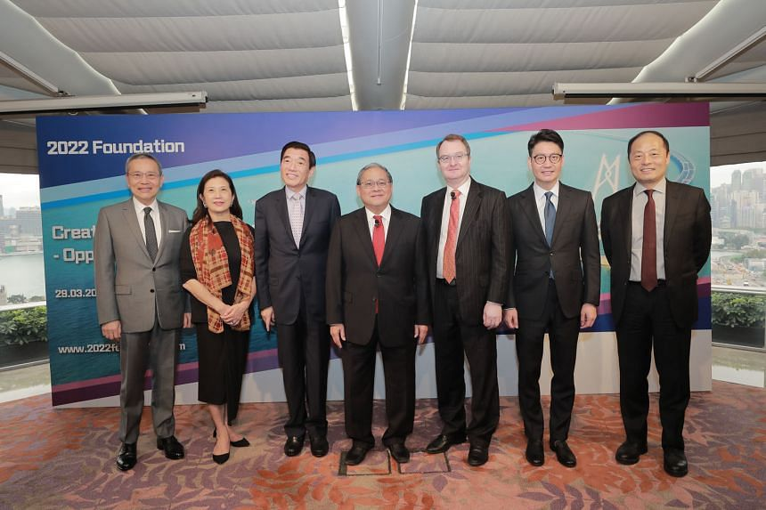 The study was carried out by a team of economists under Professor Michael Enright (third from right). It was overseen by a steering committee whose members include (from left) Mr Edward Cheng Wai-sun, deputy chairman and chief executive of Wing Tai P