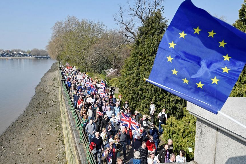 """An EU flag being waved by an anti-Brexit protester (not in photo) during a pro-Brexit rally in London yesterday. The rise of anti-globalisation sentiment that led to Brexit and US President Donald Trump's election triggered a """"reshuffling of cards"""" a"""