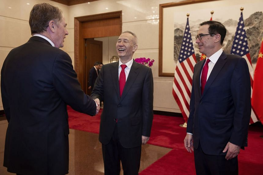 China's Vice-Premier Liu He with US Trade Representative Robert Lighthizer (left) and US Treasury Secretary Steven Mnuchin at the Diaoyutai State Guesthouse in Beijing yesterday. Chinese and US negotiators have been working line-by-line through the