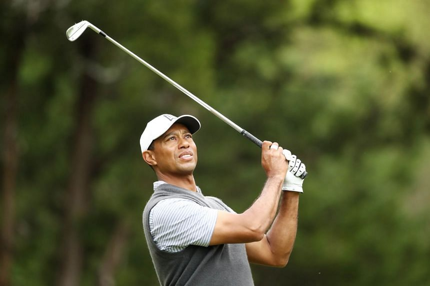 Tiger Woods plays his shot from the fourth tee in his match against Patrick Cantlay.