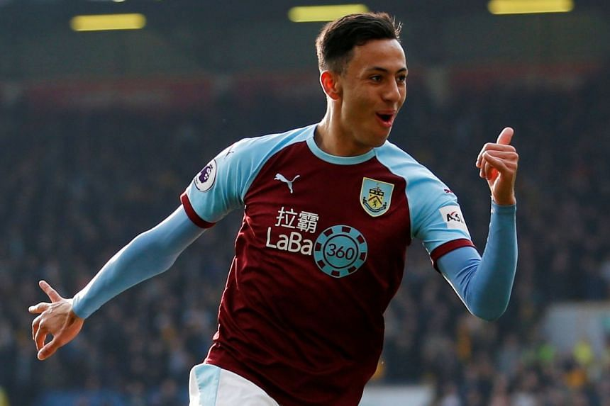 Burnley's Dwight McNeil celebrates scoring their second goal.