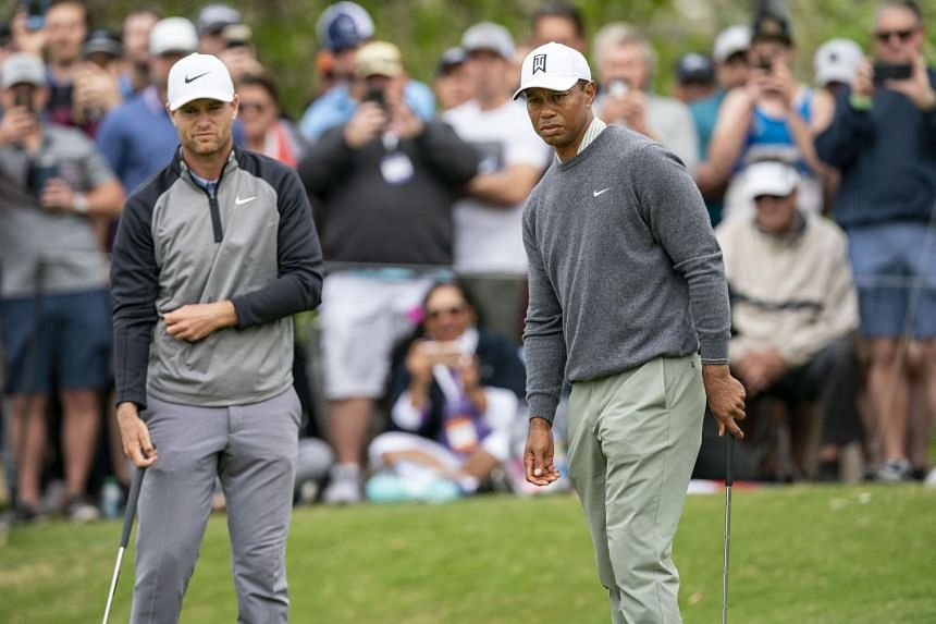 Lucas Bjerregaard and Tiger Woods on the 16th green in the quarter-finals of the WGC-Dell Technologies Matchplay golf tournament at Austin Country Club in Texas on March 30, 2019. The Dane won on the final hole.