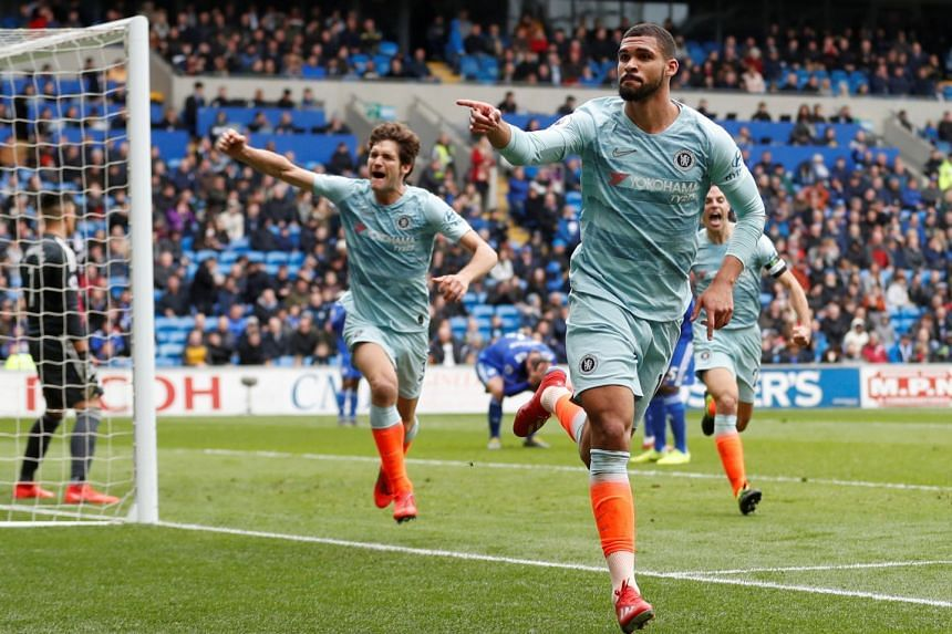 Chelsea's Ruben Loftus-Cheek celebrating with teammates after scoring their second goal against Cardiff in their English Premier League match at Cardiff City Stadium, Wales on March 31, 2019.