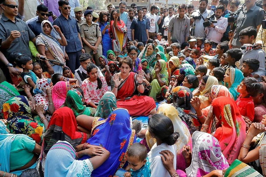 Mrs Priyanka Gandhi Vadra, a leader of India's main opposition Congress party and sister of party president Rahul Gandhi, speaking with women during an election campaign meeting in Ayodhya, India, last Friday.