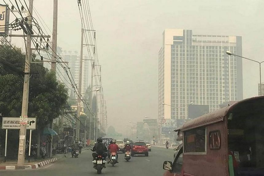 Residents in Chiang Mai (left) and northern Thailand have been advised to stay inside air-conditioned buildings and avoid all outdoor activities as air pollution hits hazardous levels.