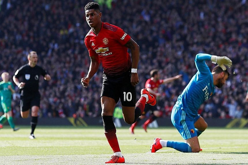Manchester United forward Marcus Rashford celebrating scoring the opening goal, while Watford goalkeeper Ben Foster vents his frustration in United's 2-1 Premier League win yesterday - Ole Gunnar Solskjaer's first since being appointed as permanent m