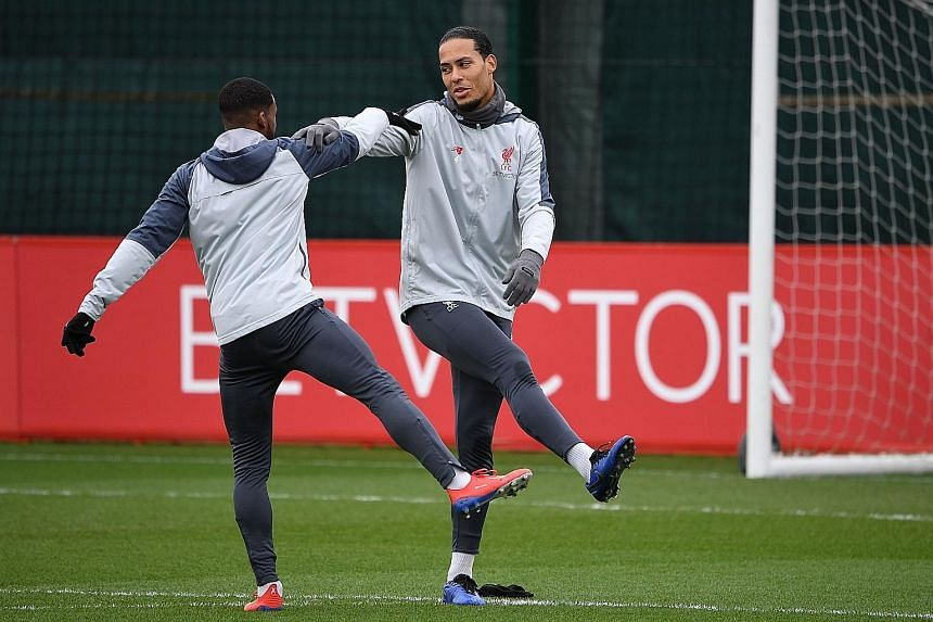 """Liverpool defender Virgil van Dijk, training with midfielder Georginio Wijnaldum, has told his teammates to have """"no regrets"""" as they try to deliver a first league title in 29 years to Merseyside."""