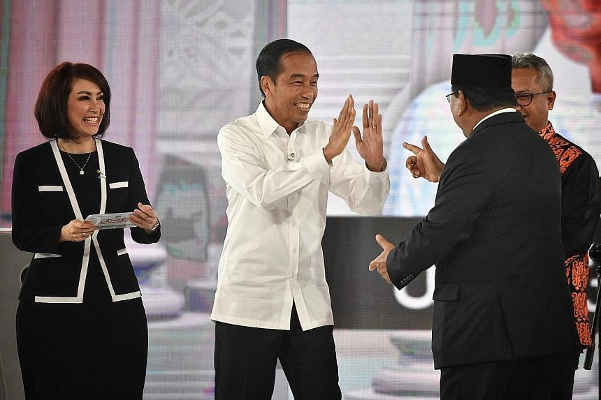 President Joko Widodo and his rival Prabowo Subianto engaging in a lively debate last night ahead of the April 17 elections. Mr Prabowo (above) even quoted Greek historian Thucydides to emphasise his desire for a strong military.