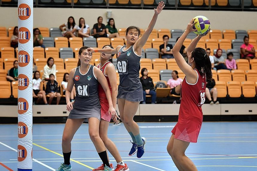 Llabten Narwhals' 17-year-old player Rachel Ling jumping to block the Swifts goal shooter. Narwhals won 54-49 to secure a semi-final spot.