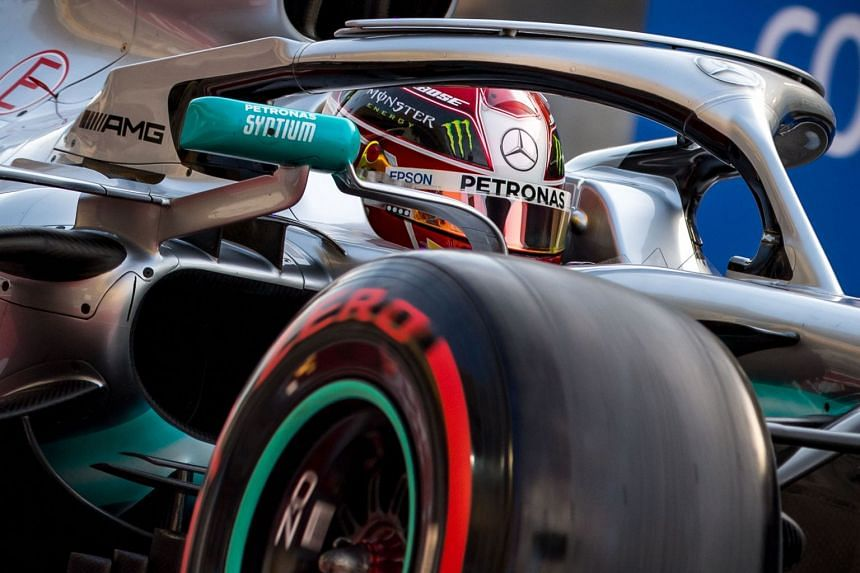 Mercedes' British driver Lewis Hamilton steers his car during the third practice session.