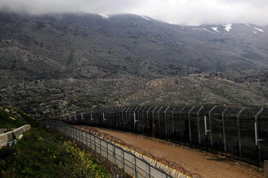 Fences are seen on the ceasefire line between Israel and Syria in the Israeli-occupied Golan Heights, on March 25, 2019.