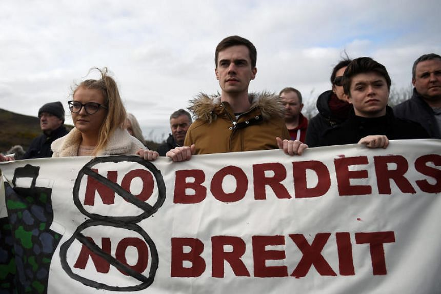 People attend a protest against Brexit at the border crossing between the Republic of Ireland and Northern Ireland in Carrickcarnon, Ireland, on March 30. 2019.