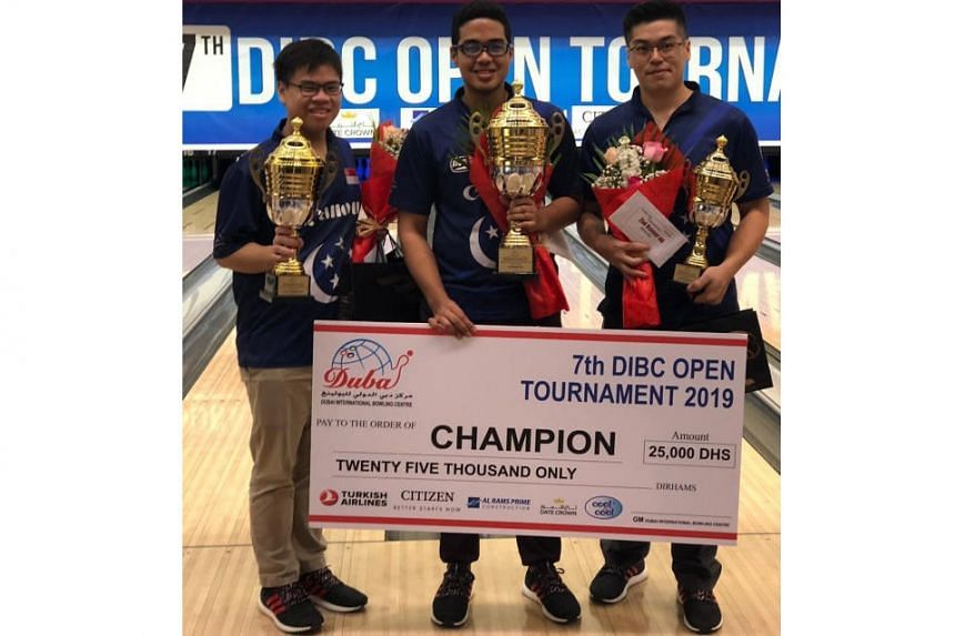 Muhd Danial (centre) finished top ahead of second-placed Timothy Tham (left), Marcus Lim (right).