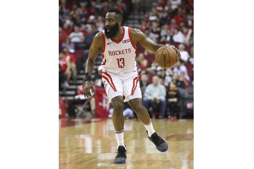 Houston Rockets guard James Harden dribbles against the Sacramento Kings in the first quarter at Toyota Center.