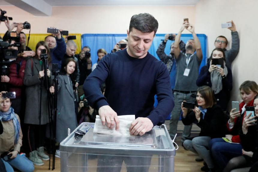 Ukrainian comic actor and presidential candidate Volodymyr Zelenskiy casts his ballot at a polling station during a presidential election in Kiev, Ukraine, on March 31, 2019.