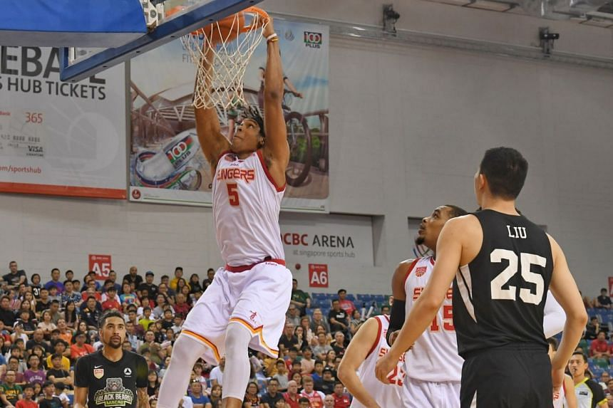 Singapore Slingers' John Fields, who top scored with 31 points, dunking against the Macau Black Bears at the OCBC Arena on March 31, 2019. His team won the first game of the Asean Basketball League play-offs quarter-final 102-91.