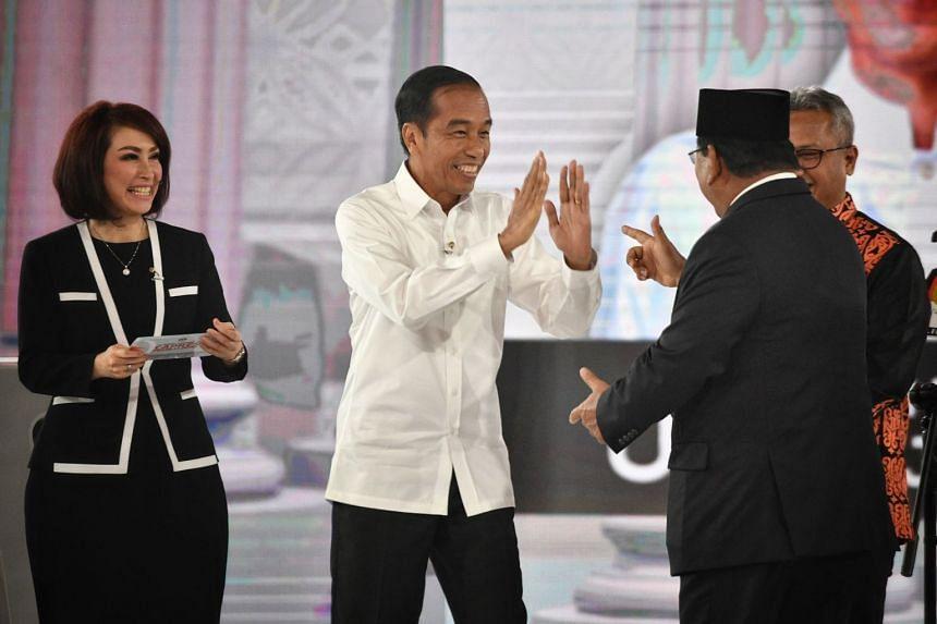 President Joko Widodo (left) and his rival Prabowo Subianto at the presidential debate showdown.