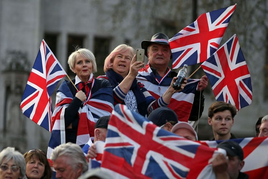 Pro-Brexit supporters holding Union flags attend a rally in London on March 29, 2019.