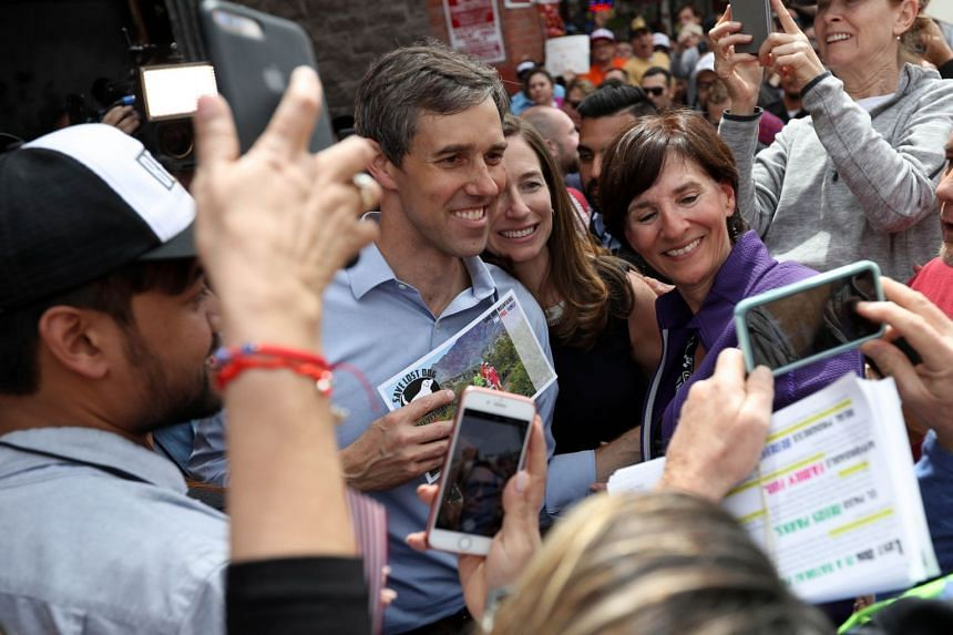 O'Rourke and wife Amy greet supporters during a campaign rally in El Paso, Texas.