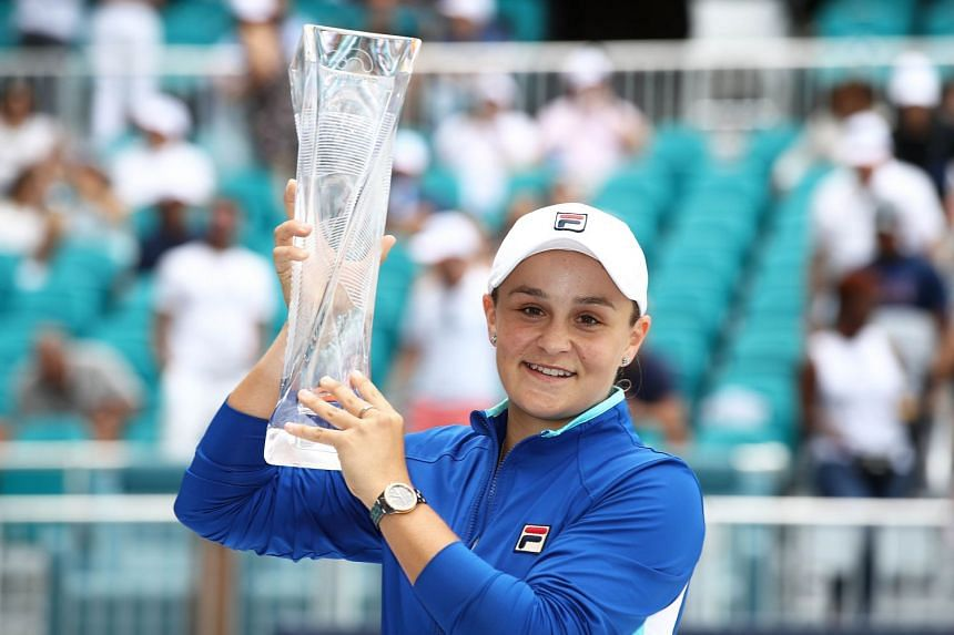 Barty celebrates with the trophy after her win against Karolina Pliskova of the Czech Republic.
