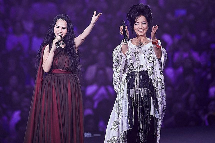 Taiwanese singers Michelle Pan (left) and Chyi Yu (right) performing at the Taipei Arena last June.