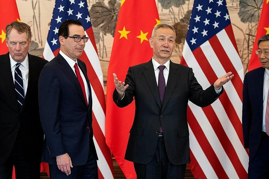 (From right) Chinese Vice-Premier Liu He with US Treasury Secretary Steven Mnuchin and US Trade Representative Robert Lighthizer at Diaoyutai State Guesthouse in Beijing last Friday. Mr Liu will lead a delegation to Washington on Wednesday to continu