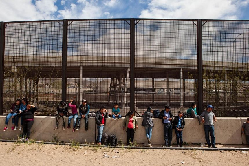 A group of migrants from Honduras, Guatemala and Salvador awaiting processing underneath the Paso Del Norte Bridge in El Paso, Texas. US Customs and Border Protection has temporarily closed all highway checkpoints along the 430km stretch of border in