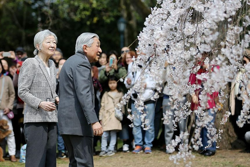 Japan's Emperor Akihito and Empress Michiko admiring cherry blossoms at Kyoto Gyoen National Garden last Wednesday. The Emperor will abdicate from the Chrysanthemum throne on April 30, making way for Crown Prince Naruhito to replace him the following