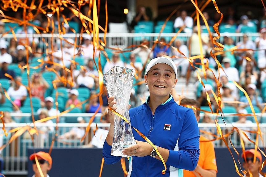 Ashleigh Barty of Australia celebrating with her Miami Open trophy - the most significant victory of her career - on Saturday.