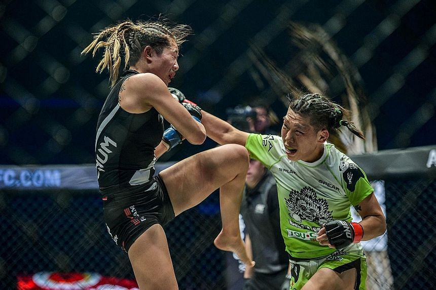 Angela Lee (in black) lost her challenge for the strawweight title of China's Xiong Jingnan in Tokyo yesterday. Now, instead, Xiong plans to drop a weight class to contest for Lee's atomweight title.