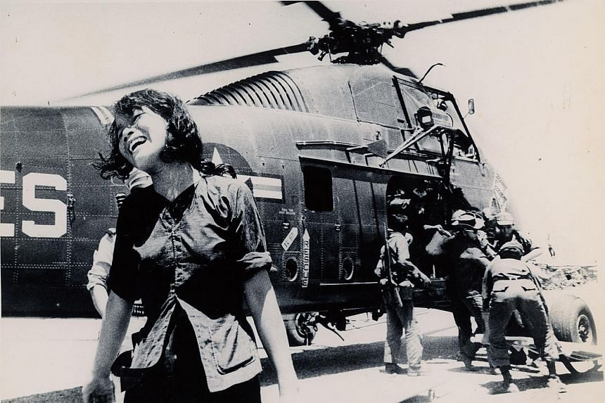A widow and her killed-in-action husband being evacuated to Quang Ngai airstrip in 1965.