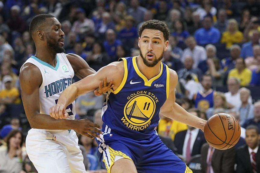 Klay Thompson (right) added 24 points and along with Stephen Curry, combined to make 11 three-pointers, as the Golden State Warriors overcame the second-quarter ejection of DeMarcus Cousins for a flagrant foul.
