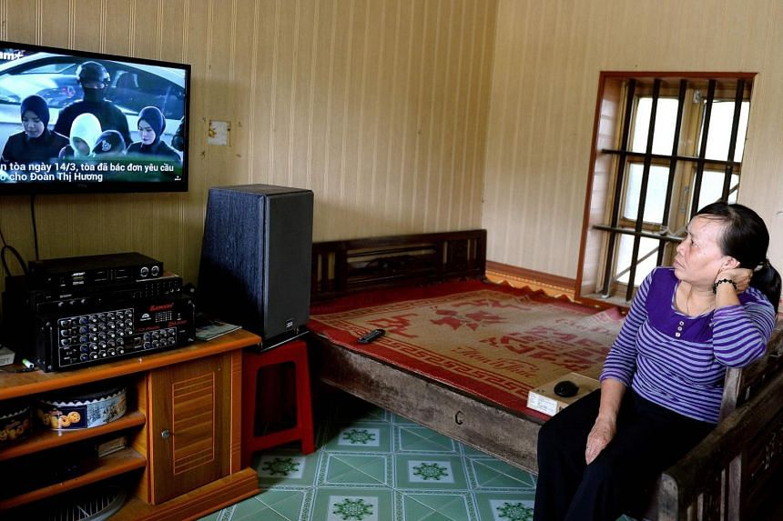 Ms Nguyen Thi Vy, stepmother of Vietnamese national Doan Thi Huong, watches the news from Malaysia of the verdict on a television at her house in Nam Dinh, Hanoi, on April 1, 2019.